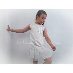 Vestido beige brillante con falda plisada de Eve Children